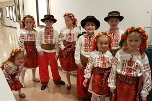 Young Ukrainian dancers wait to perform in the Art Gallery of Burlington