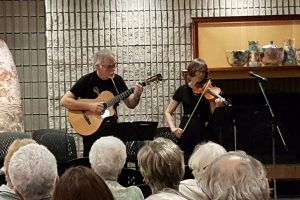 Violinist and guitarist perform in the Fireside lounge in the Art Gallery of Burlington