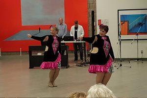 Dancers perform in the Shoreline Room in the Art Gallery of Burlington